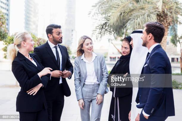 Emirati Businessman talking to his colleagues outside of work