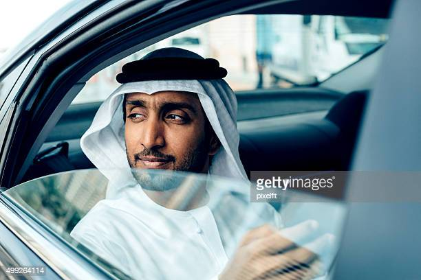 Emirati Businessman with phone in a car, Dubai