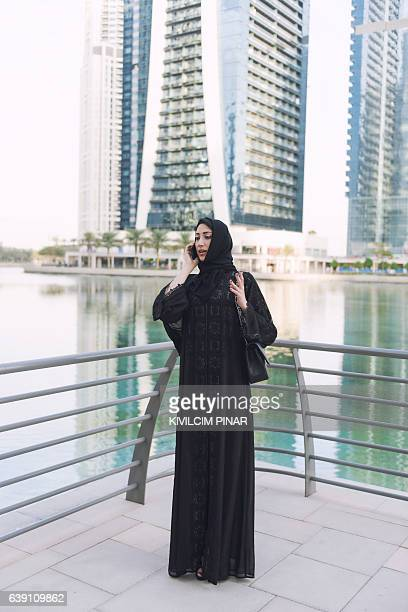 Emirati businesswoman having phone call