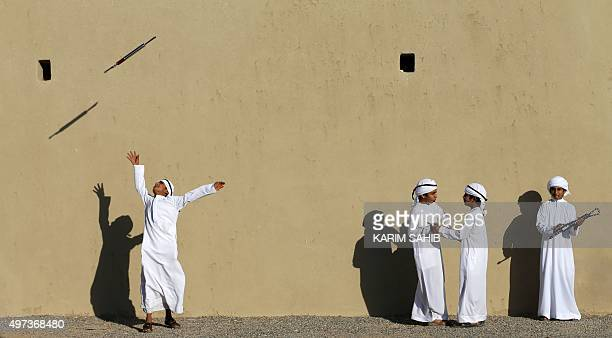 Emirati children practice a traditional dance for the celebrations of the upcoming 44th anniversary of the establishment of the United Arab Emirates...