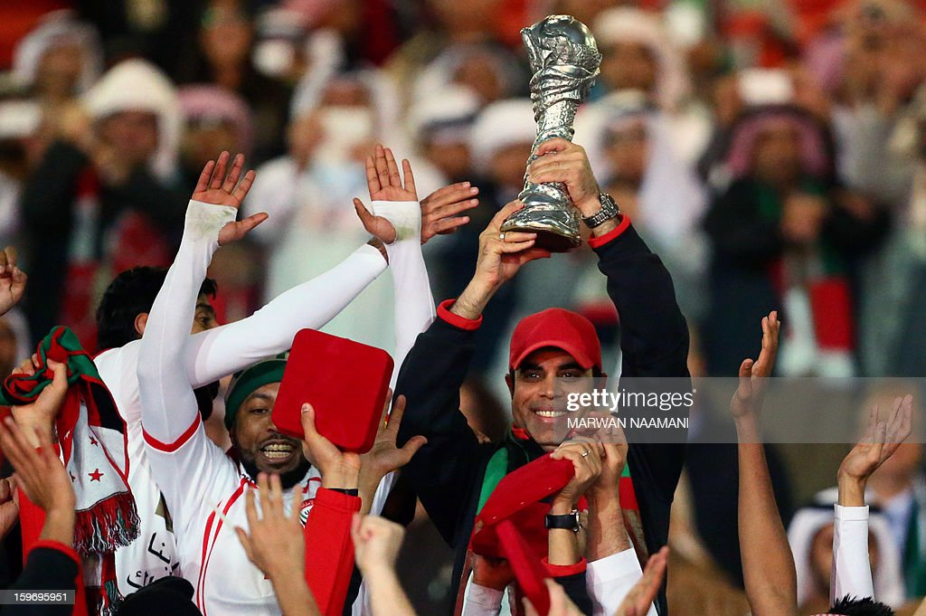 Emirati coach Mahdi Ali raises the trophy after his team won the final of the 21st Gulf Cup on January 18, 2013 in Manama. United Arab Emirates won 2-1 against Iraq.