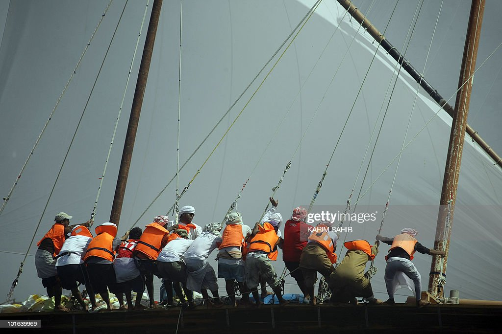 Emirati competitors pull the sails of their dhow in the Gulf off Dubai during the Al-Gaffal 60 ft traditional dhow sailing race between the island of Sir Bu Nair, near the Iranian coast, and the Gulf emirate on May 29, 2010.
