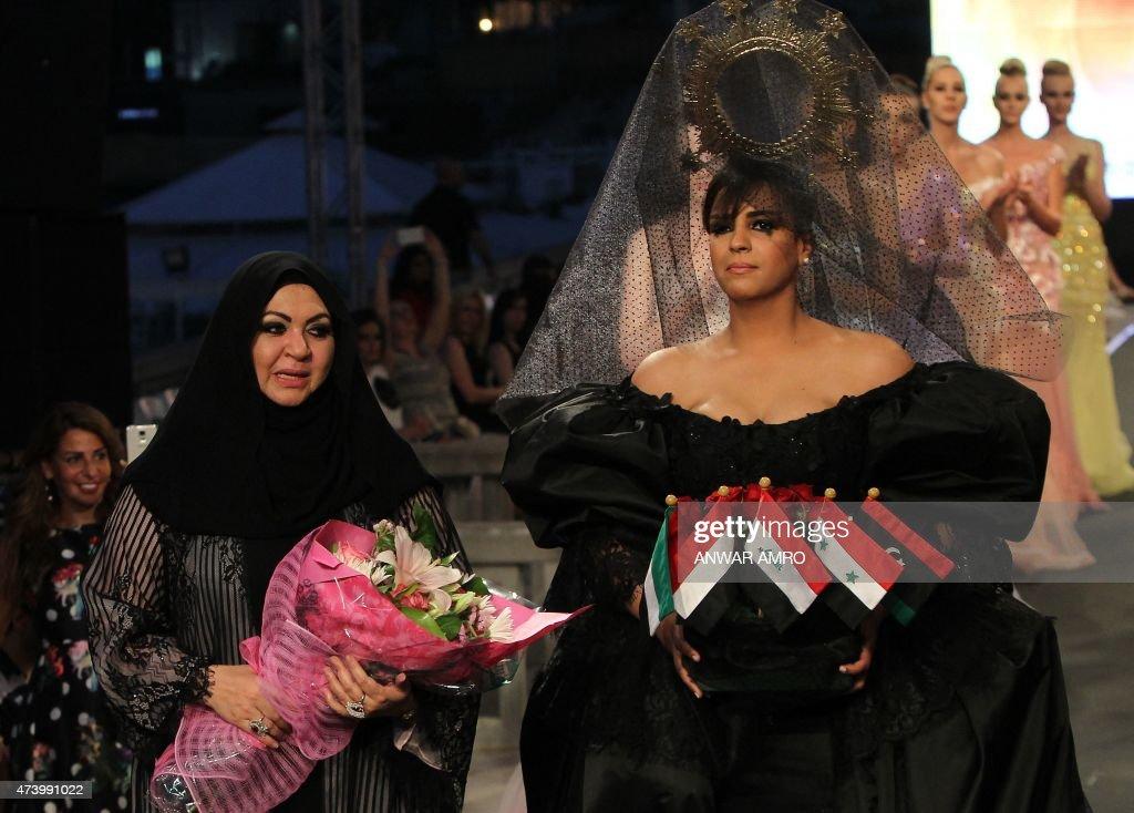 Emirati Designer Mona Al Mansouri Stands Next Emirati Singer Roueida News Photo Getty Images