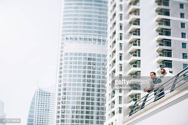 emirati e businessman doing business outdoors - human settlement stock pictures, royalty-free photos & images