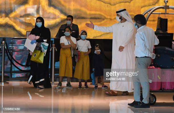 Emirati families returning to the UAE are pictured inside a hotel where they will stay 14days in quarantine amid the COVID19 on April 14 2020 in Dubai