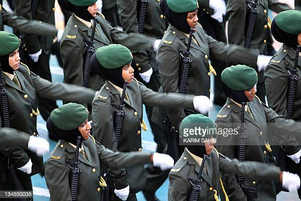 Emirati female troops march during celebrations marking the 40th anniversary of the establishment of the United Arab Emirates at Sheikh Zayed Sports...