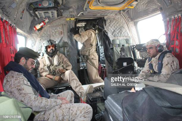 Emirati fighters from the Saudi-backed coalition forces on Yemen's west coast frontline board a helicopter at a military base in Khokha, 100...