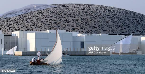 Emirati fishmen cast their nets near the Louvre Abu Dhabi on November 11, 2017. / AFP PHOTO / KARIM SAHIB