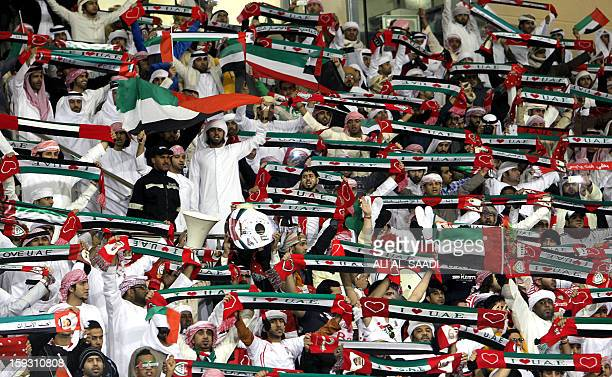 Emirati football fans cheer for their team during UAE's 21st Gulf Cup football match against Oman in the Bahraini capital Manama on January 11 2013...