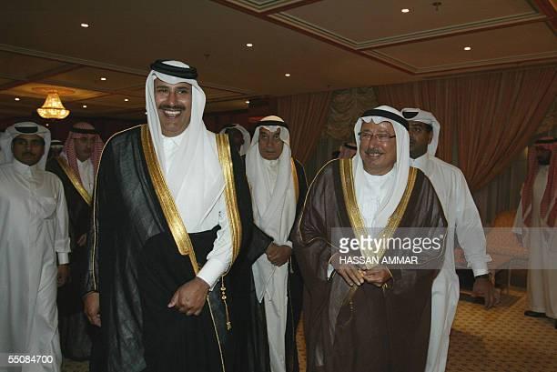 Emirati Foreign Minister Rashed Abdullah alNuaimi and his Qatari counterpart Sheikh Hamad bin Jassem bin Jabr alThani arrive for the ministerial...