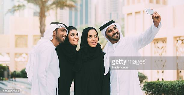 emirati friends taking a selfie