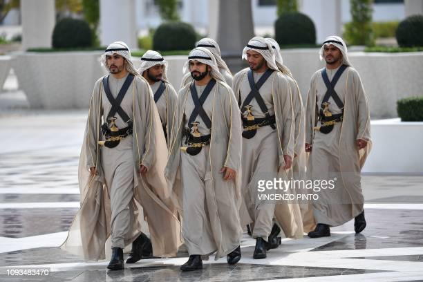 Emirati honor guard walk outside the presidential palace in the capital Abu Dhabi during a reception for Pope Francis on February 4 2019 Pope Francis...