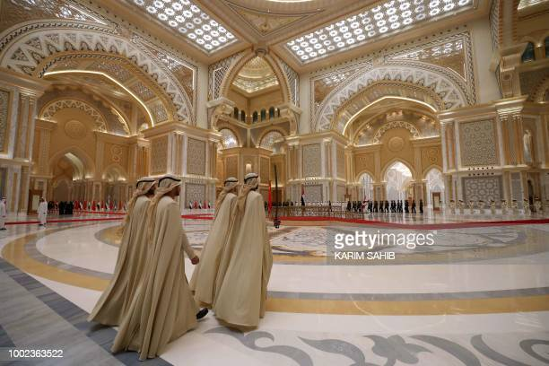 Emirati honorary guards walk through a reception hall at the presidential palace in Abu Dhabi during Chinese President Xi Jinping's visit to the UAE...