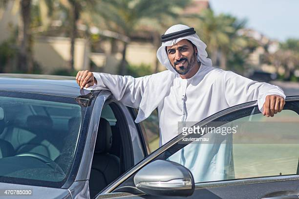 Emirati man getting on his car