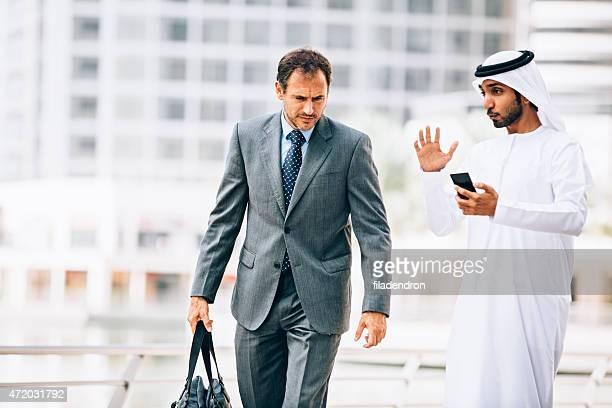 Emirati man having outdoors business meeting