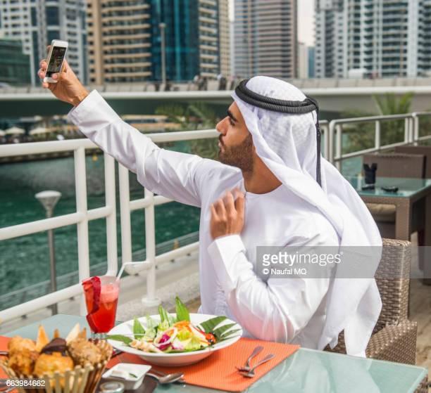 Emirati man taking selfie