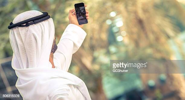 Emirati Man taking selfie with his phone
