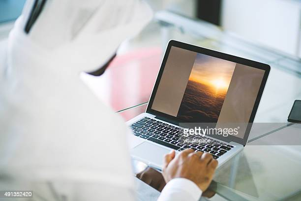Emirati Man Using Laptop at Home