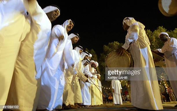 Emirati men dance during a mass wedding ceremony in the emirate of Umm alQaiwain on June 14 2009 Marriage in the Gulf state with its majority...