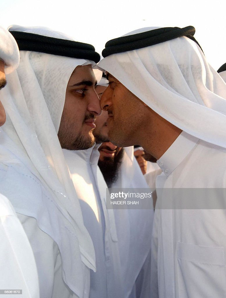 Emirati men exchange Eid greetings with the traditional nose kiss after the Eid al-Fitr prayer at the Grand Mussallah in the Gulf emirate of Dubai, 03 November 2005. Muslims around the world are celebrating the holidays of Eid al-Fitr which follow the holy fasting month of Ramadan.