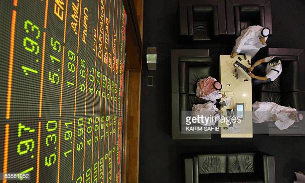 Emirati men follow the market's movements at the Dubai Financial Market on November 6 2008 Stock markets in the oilrich Gulf region closed lower on...