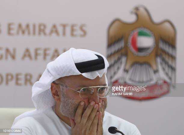 Emirati minister of state for foreign affairs Anwar Gargash gestures during a press conference in Dubai about the situation in Yemen on August 13...