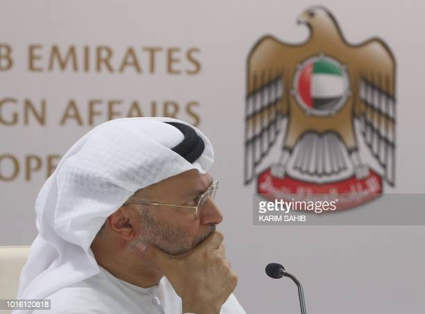 Emirati minister of state for foreign affairs Anwar Gargash listens during a press conference in Dubai about the situation in Yemen on August 13 2018...