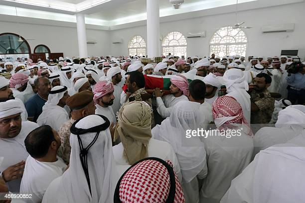 Emirati mourners carry the body of Mohammed Khaled Mohammed Mamdi an Emirati armed forces' soldier who was killed the previous day in Yemen's eastern...