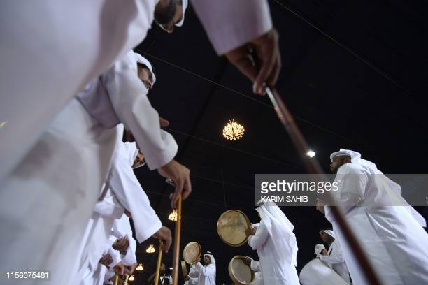 Emirati musicians perform during the annual Liwa Date Festival in the western region of Liwa on July 17, 2019. - The Liwa Date Festival aims to...