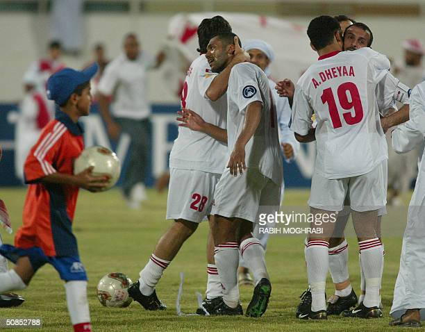 Emirati players Mohammed Yussef , Said Al-Kass , Ahmad Dia and Mohammed Youssef of the Emirati Al-Sharjah club celebrate after their victory over...