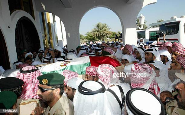 Emirati relatives and officials carry the coffin of Sheikh Zayed bin Sultan alNahayan during his funeral in Abu Dhabi 03 November 2004 Nahayan the...
