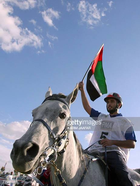 Emirati Sheikh Majid alMaktoum the son of Dubai ruler Sheikh Mohammed bin Rashid alMaktoum waves his country's flag after winning the gold medal in...