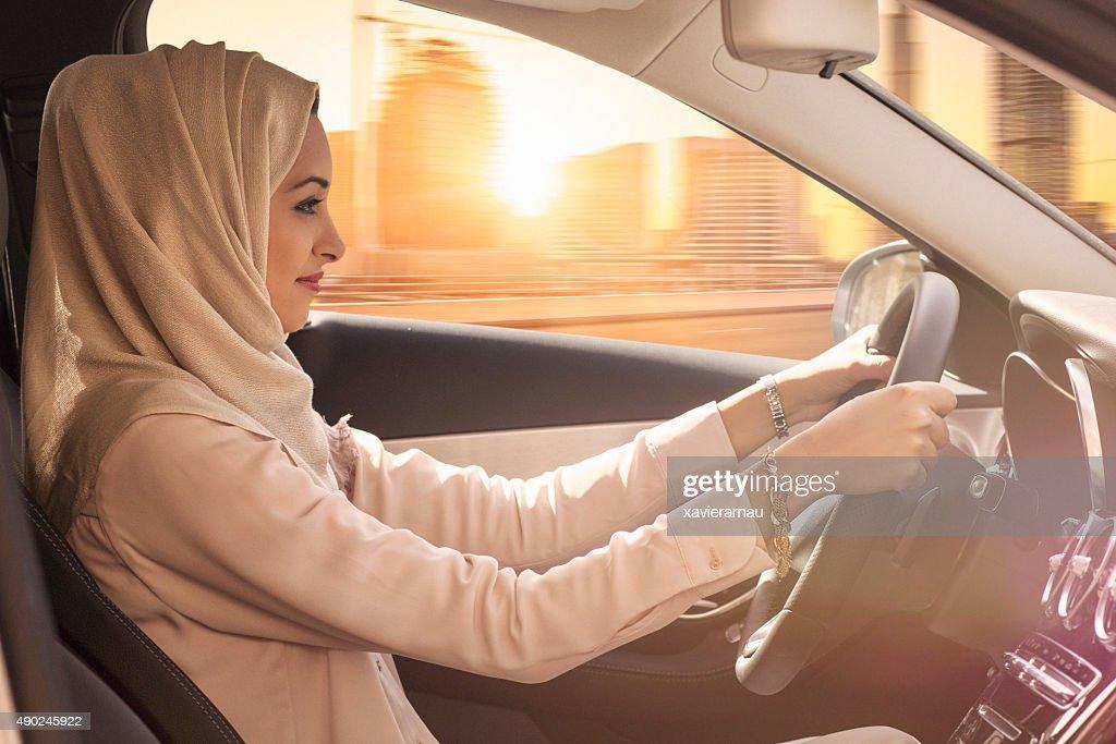 Emirati woman driving a car in Dubai : Stock Photo