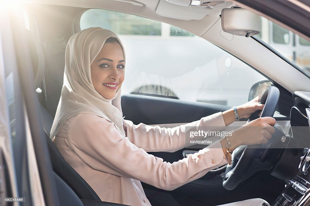 Emirati woman driving a car : Stock Photo