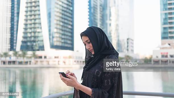 Emirati woman texting