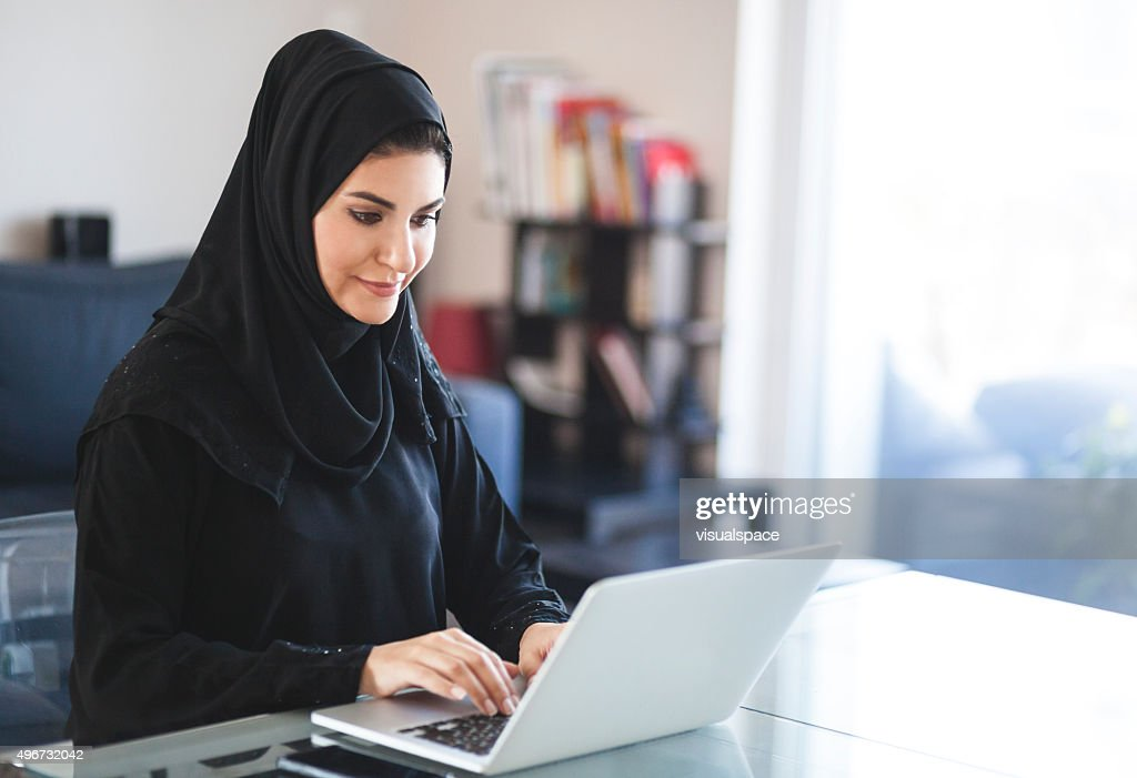 Emirati Woman Working with Laptop at Home : Stock Photo
