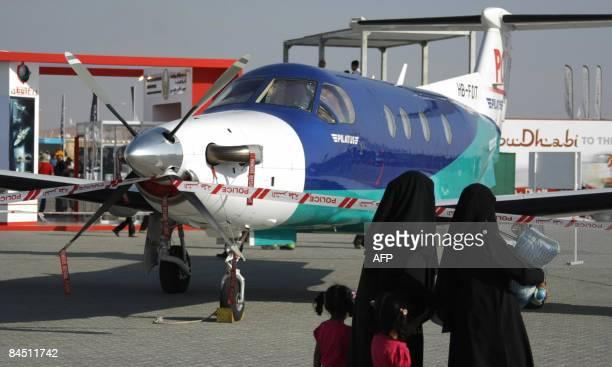 Emirati women and their children visit the AlAin International Aerobatics Show at the Gulf emirate's airport on January 28 2009 AFP PHOTO/KARIM SAHIB