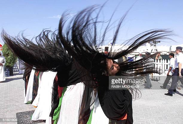 Emirati women dance during a show at the opening of the Dubai Air Show 14 November 1999 More than 500 firms from 36 countries are taking part in what...