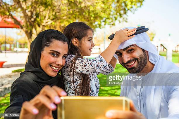 Emirati young family in Dubai taking a selfie