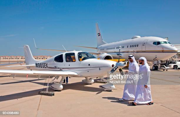 Emiratis attend the Abu Dhabi Air Expo 2018 at the AlBateen Executive Airport on the outskirts of the Emirati capital on February 26 2018 / AFP PHOTO...