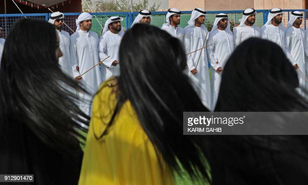 Emiratis attend the Sheikh Sultan Bin Zayed alNahyan camel festival at the Shweihan racecourse in alAin on the outskirts of Abu Dhabi on February 1...