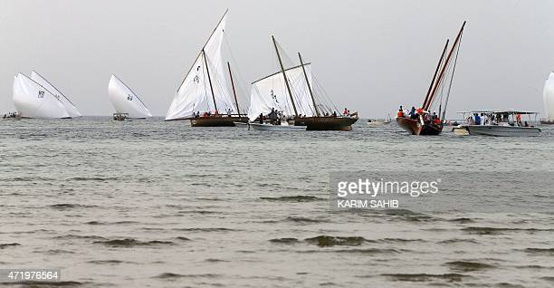 Emiratis compete in a traditional dhow sailing race during the alGharbia Watersports festival on May 2 2015 off the coast of alMirfa beach outside...