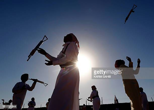 Emiratis dance Al Uala during the Sheikh Sultan Bin Zayed alNahyan Camel Festival held at the Shweihan racecourse in the outskirts of Abu Dhabi on...