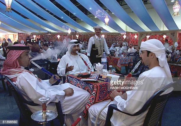 Emiratis enjoy their waterpipes or narjila in alFawaniss tent in Dubai 11 December 1999 During the holy month of Ramadan when Muslims fast from dawn...
