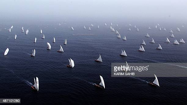 Emiratis sail during the AlGaffal 60ft traditional dhow sailing race between the island of Sir Bu Nair near the Iranian coast and the Gulf emirate on...