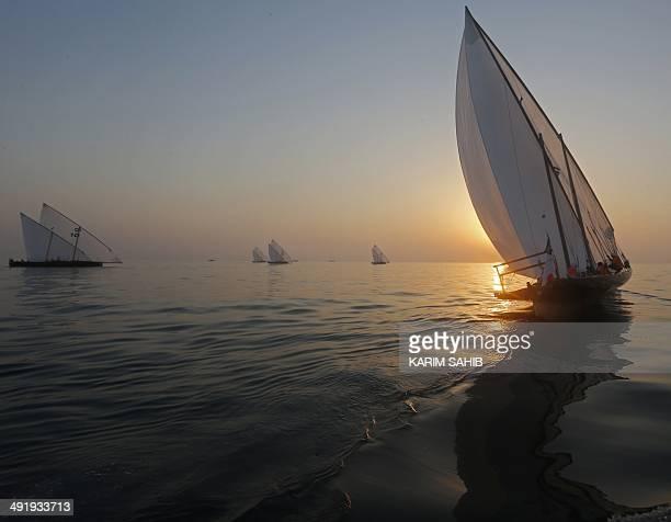 Emiratis sail during the AlGaffal traditional longdistance dhow sailing race Dubai's to win the AlGaffal traditional longdistance dhow sailing race...