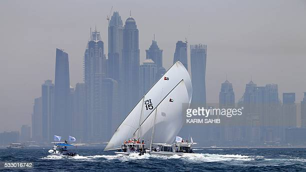 Emiratis sailors compete in the AlGaffal traditional longdistance dhow sailing race between the island of Sir Bu Nair near the Iranian coast and the...