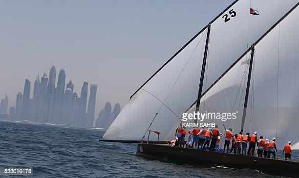 Emiratis sailors on board the Zilzal the boat of UAE Prime Minister and Dubai Ruler celebrate after winning the AlGaffal traditional longdistance...