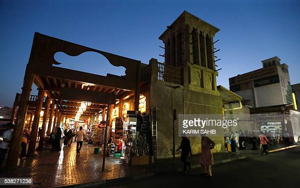 Emiratis shop at the Deira Spice Souk ahead of the Muslim fasting month of Ramadan on June 5 2016 in Dubai More than 15 billion Muslims around the...