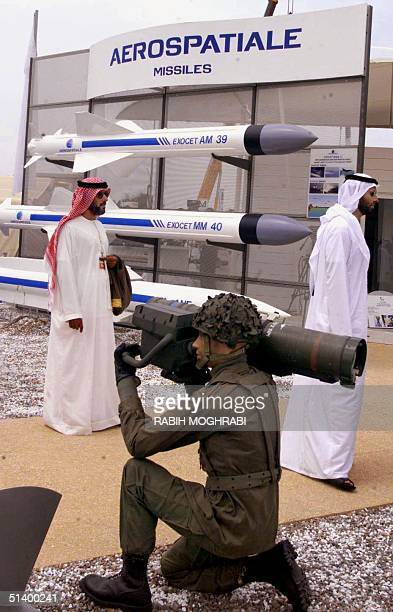 Emiratis visit a French stand displaying missiles in Abu Dhabi 14 March 1999 at the International Defence Exhibition and Conference 99 Despite a cash...